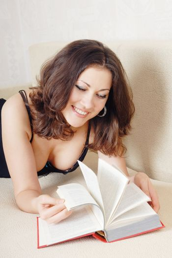 Adult smiling woman reading the book