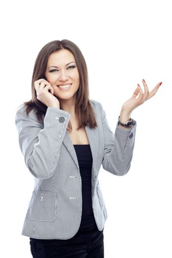 Business lady talking via cell phone on a white background