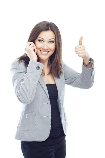 Businesswoman talking by cell phone and making OK sign