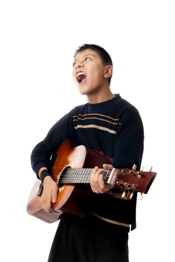 Boy playing guitar and singing a rock song