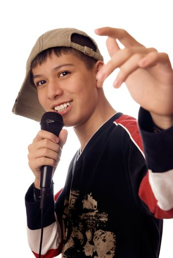 Photo of smiling boy singing a rap song