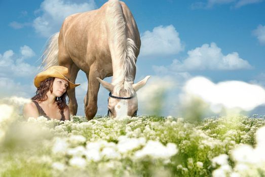 Photo of serene woman sitting near her horse