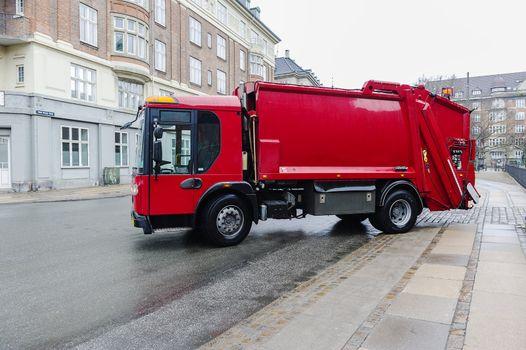 Red garbage disposal truck