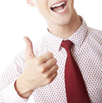 Successful unrecognizable businessman making thumbs up gesture