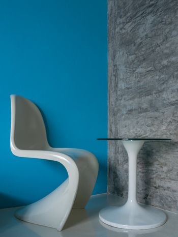 Glossy white chair and table at comfortable corner