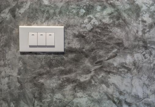 The light controller on plain texture wall