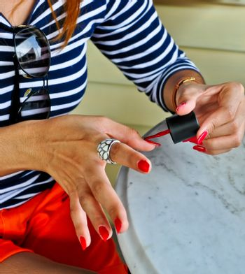 Self nail painting by red color