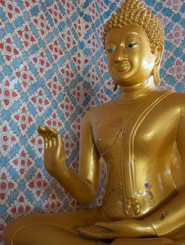Shiny Budda in Thai temple, Ranong province, Thailand