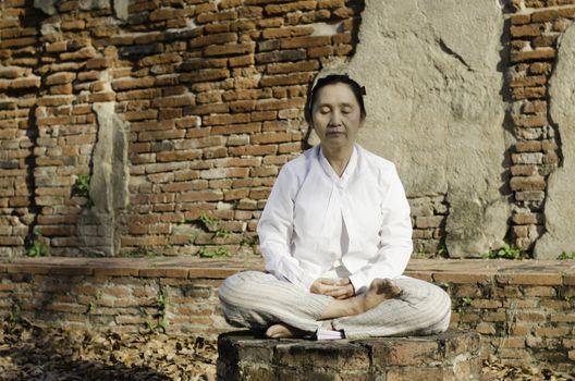 Buddhist woman meditating