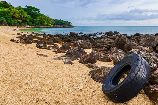 Washed out tyre at beautiful ocean coast in Andaman sea