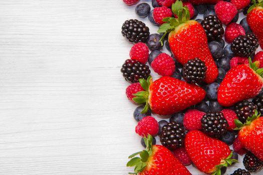 Berry over white  Wood. Strawberries, Raspberries, Blueberry