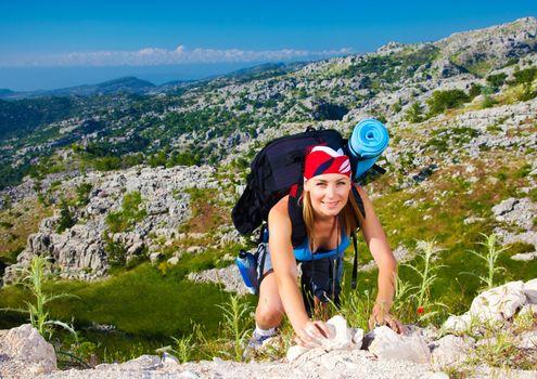 Teen girl climb on mountain