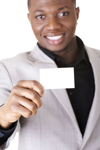 Businessman with blank business card, isolated on white