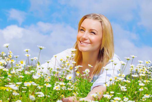 Pretty woman on daisy field
