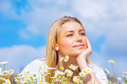 Pretty woman on daisy meadow
