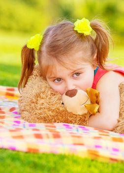 Cute child with teddy bear