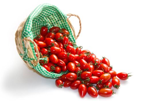 fresh tomatoes in basket on a white background