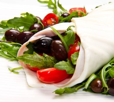 mozzarella roll with tomatoes,olives and salad