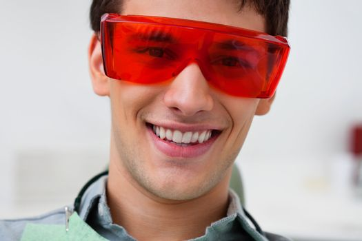 Portrait of dental patient wearing protective eyewear