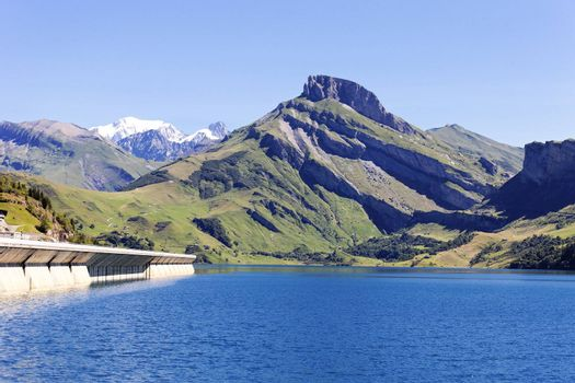 alpine landscape with lake and dam in France