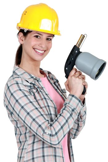 Woman holding blow-torch