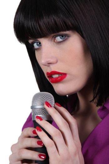 female singer caressing a micro