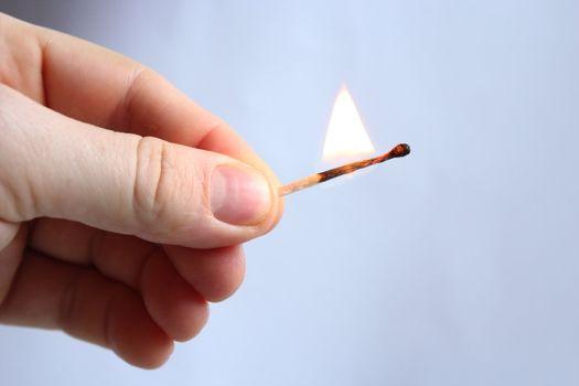 Hand with struck match