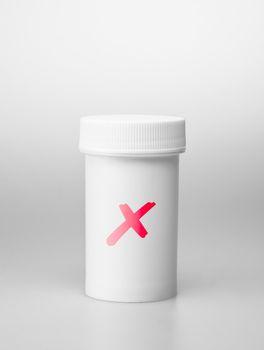 Small white medecine bottle