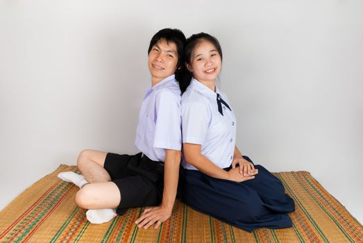 Lovers of High School Asian Thai Students are sitting together