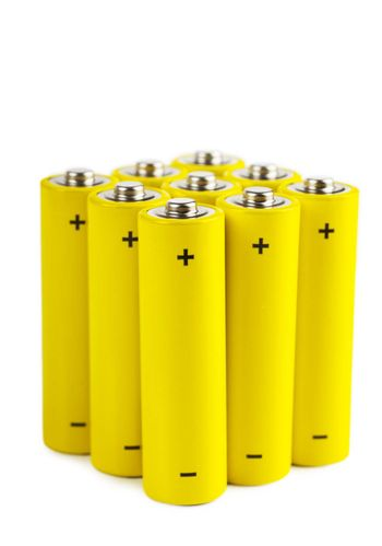 Bunch of yellow batteries isolated over white background
