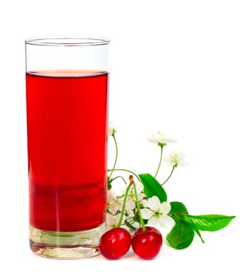 Juice with fresh cherries leafs and flowers isolated on white background