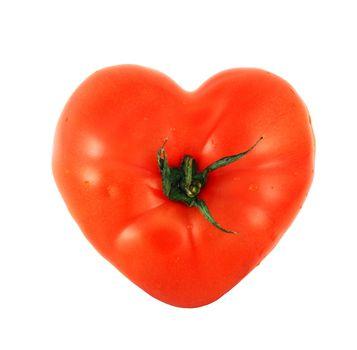 One tomato shaped like heart isolated on white background