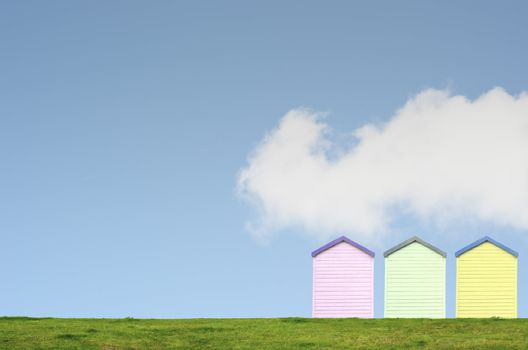 Colourful Beach Huts on Blue Sky