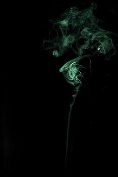 delicate light green smoke on black background