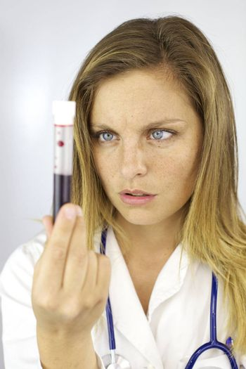 Female doctor observing blood sample