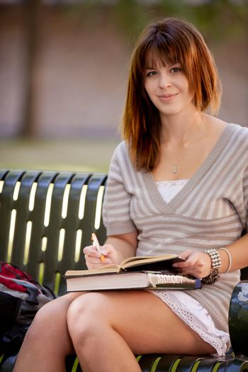 Student Writing in Journal Outdoors