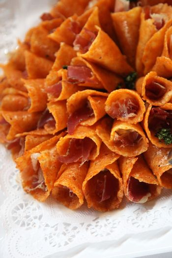 Close up of a plate of brandy snap cones