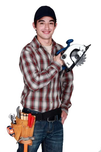 Young man with an electric saw