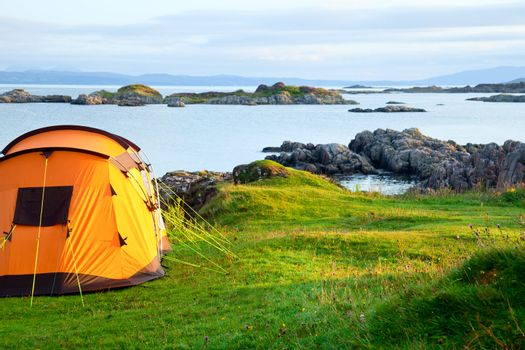 Camping tent on ocean shore