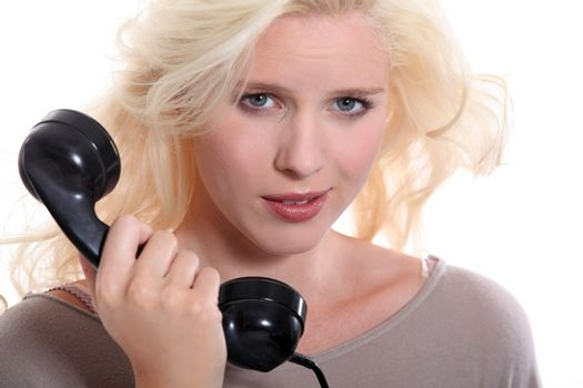 Woman with an old-fashioned telephone handset