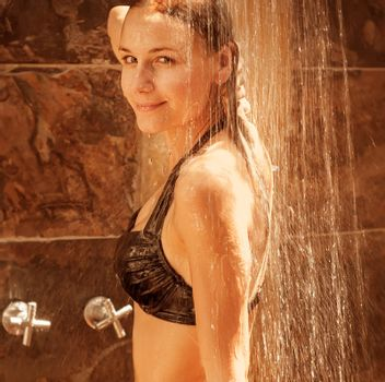 Young lady take shower