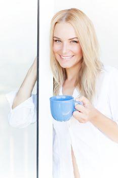 Blond woman drink tea