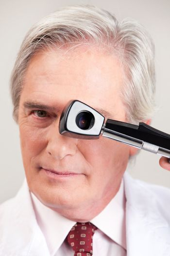 Optometrist with Opthalmoscope