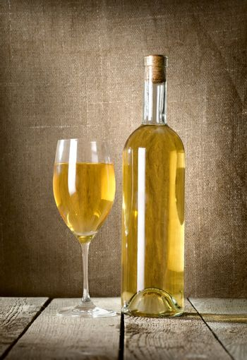 Dessert wine and glass on the canvas
