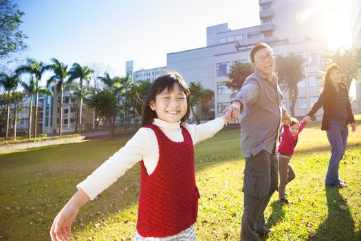 happy  family in the school with sunlight background
