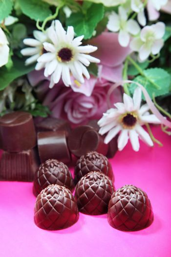 Chocolate sweets and flowers for the Valentine's Day