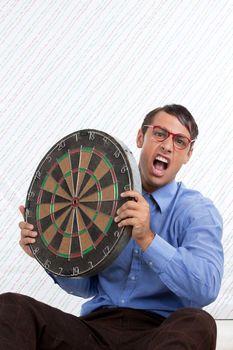 Man Holding a Dartboard