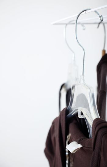 Close-up photo of the brown clothes and hangers in the dressing room