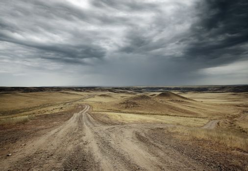 Landscape with troubled sky and two byroads in the steppe
