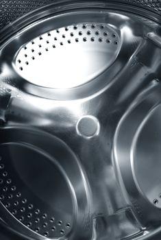 Metal circular element of washing machine. Close-up photo